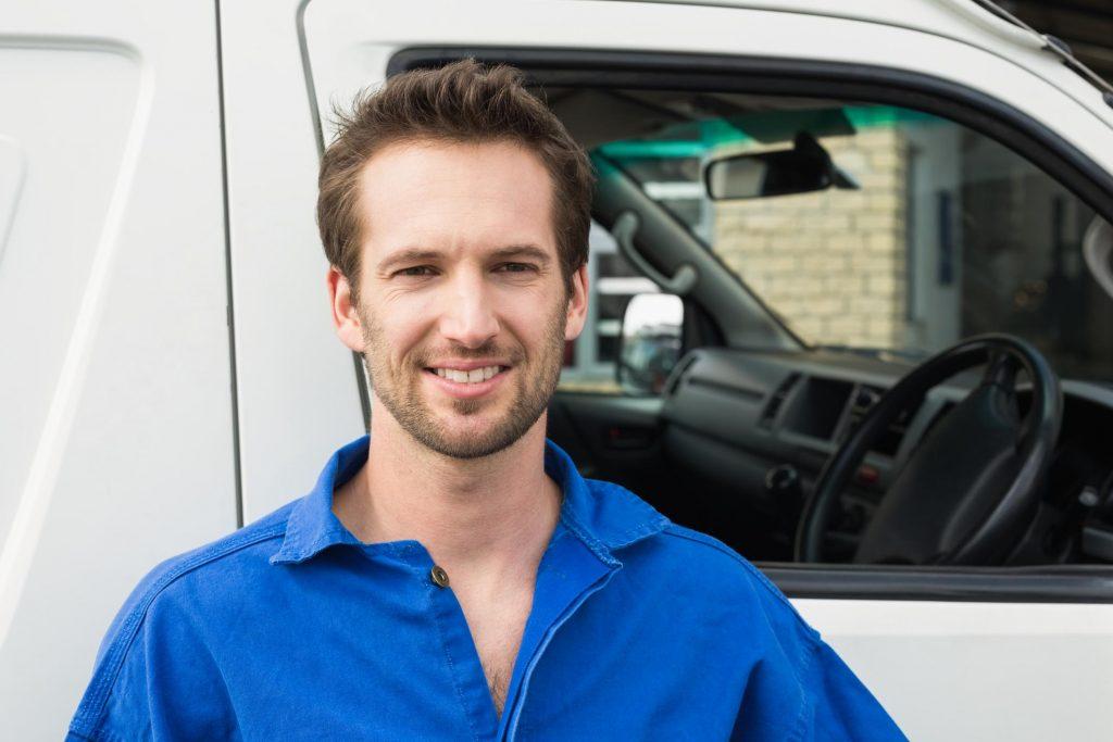 HVAC technician smiling posing