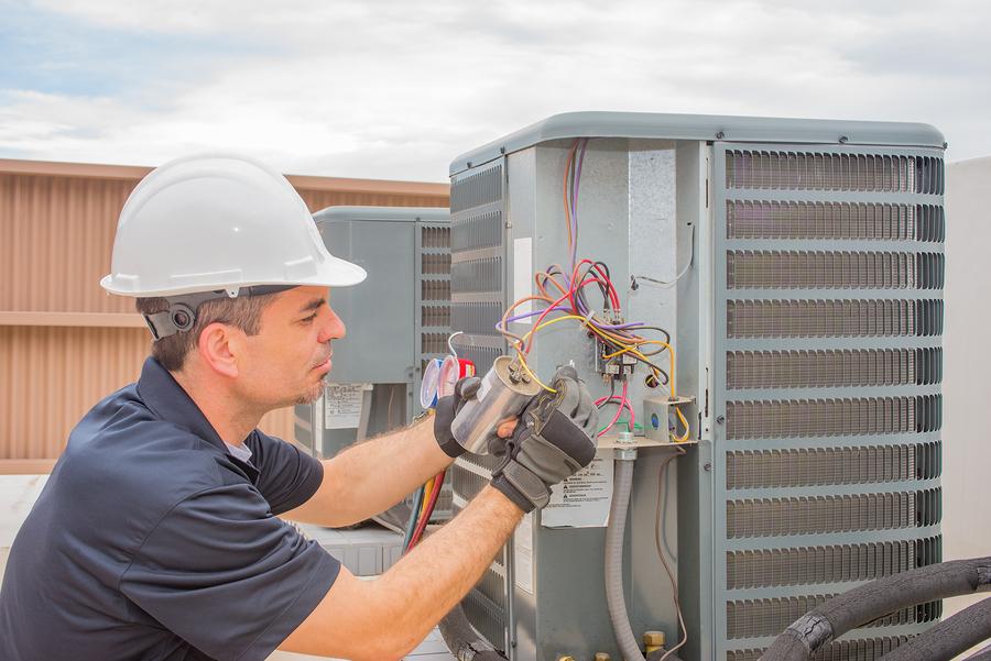 HVAC technician doing AC repair