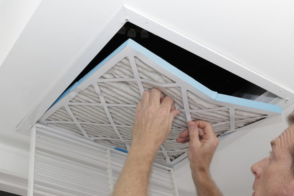 HVAC technician doing duct cleaning