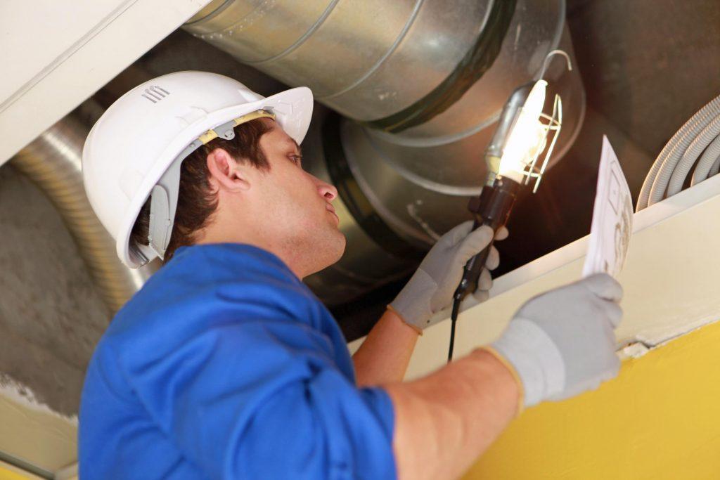 HVAC technician doing duct sealing